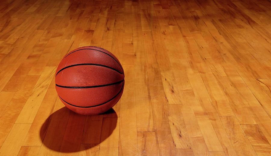 Basketball And Floor Photograph by Groveb