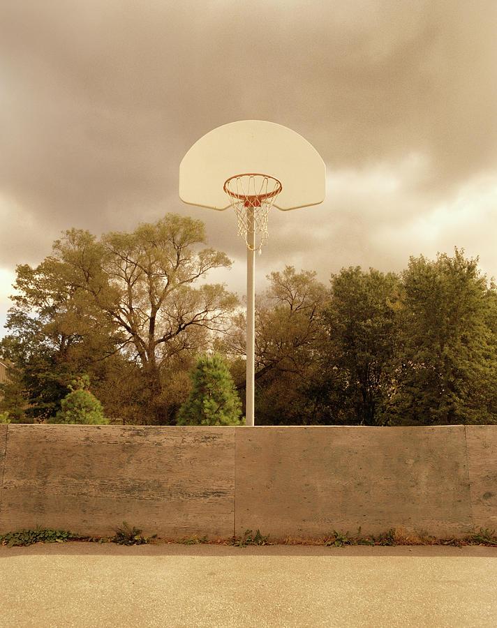 Basketball Backboard And Hoop Against Photograph by Chris Thomaidis