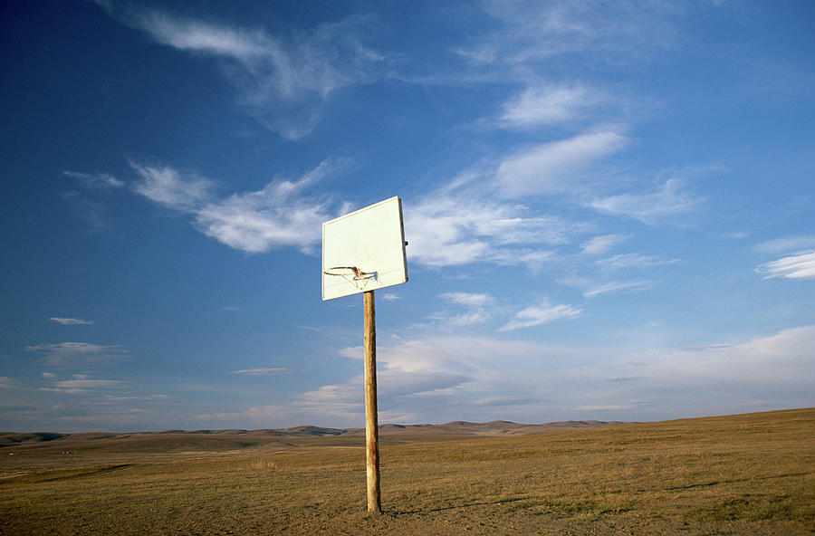 Basketball Backboard And Hoop On Rural Photograph by Peter Adams