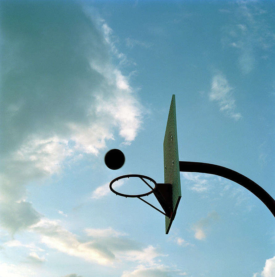 Basketball Hoop And Ball Photograph by Chris Windsor