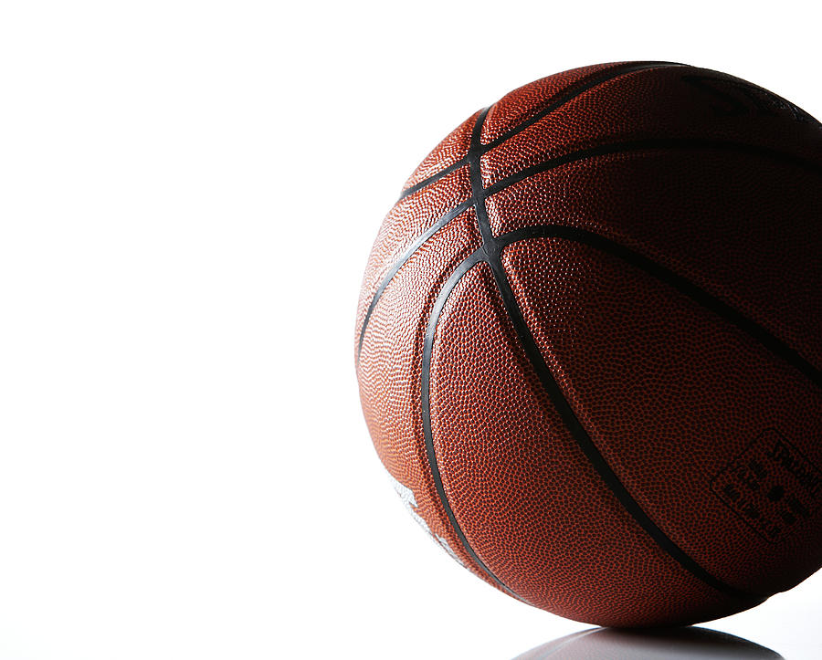 Basketball On White Background Photograph by Thomas Northcut