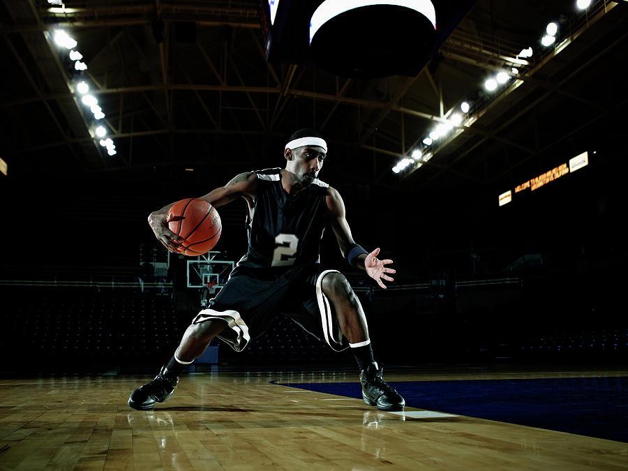 Basketball Player Dribbling Basketball Photograph by Thomas Barwick
