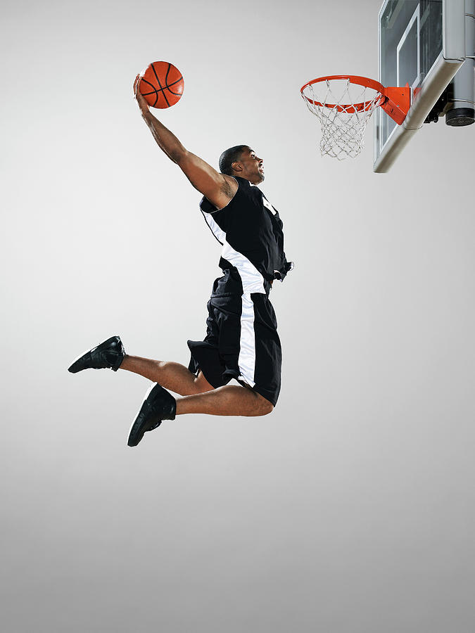 Basketball Player Dunking Ball, Low Photograph by Blake Little