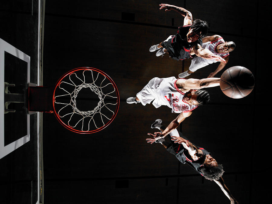 Basketball Player Dunking Ball Over Photograph by D Miralle