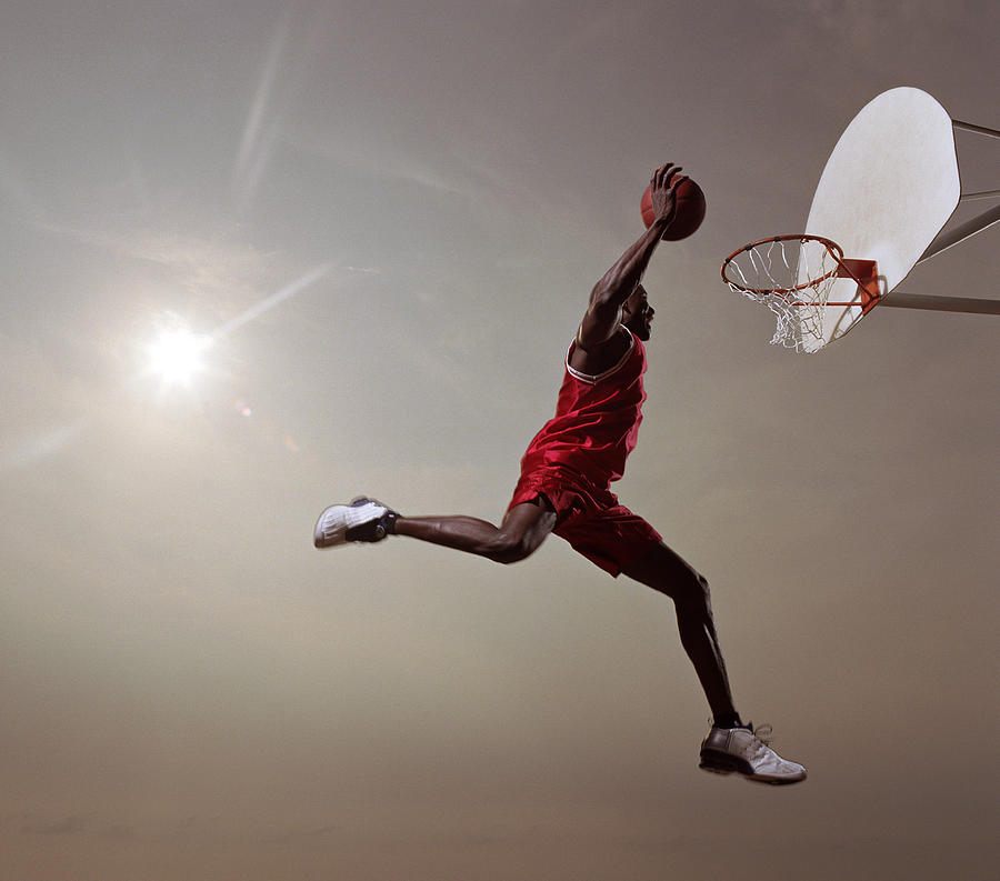 Basketball Player In Mid-air Jump Photograph by Blake Little