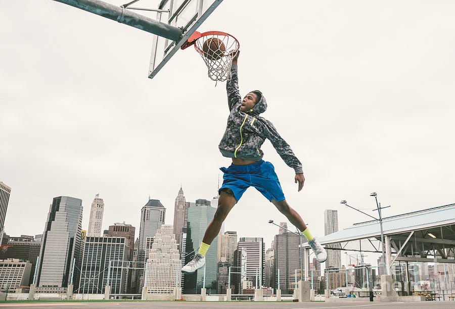 College Photograph - Basketball Player Performing Slum Dunk by Oneinchpunch