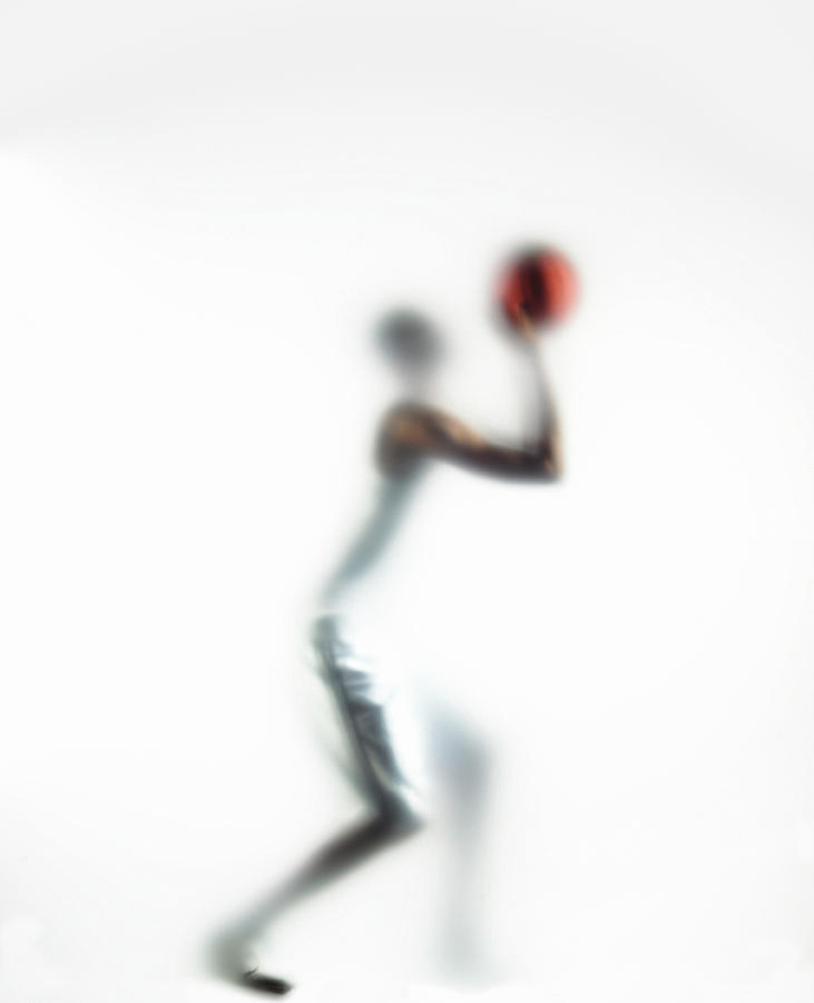 Basketball Player Shooting Ball, Side Photograph by Symphonie