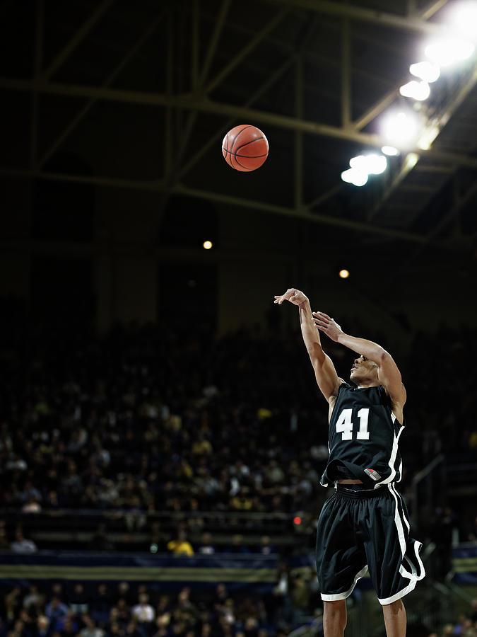 Basketball Player Shooting Jump Shot In Photograph by Thomas Barwick