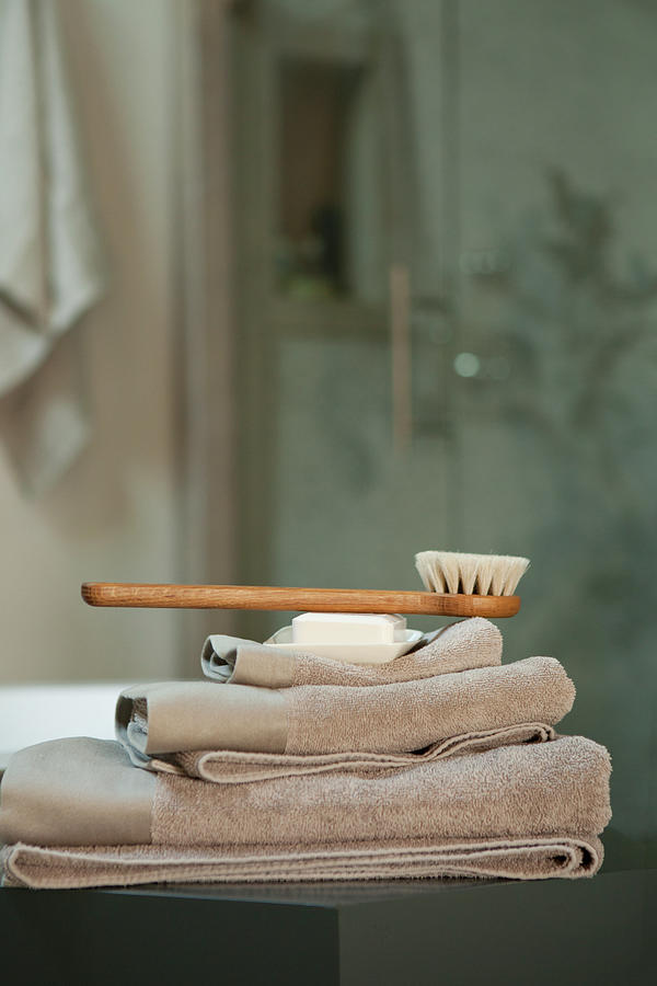 Bath Brush On Stacked Towels Photograph by Karyn R. Millet