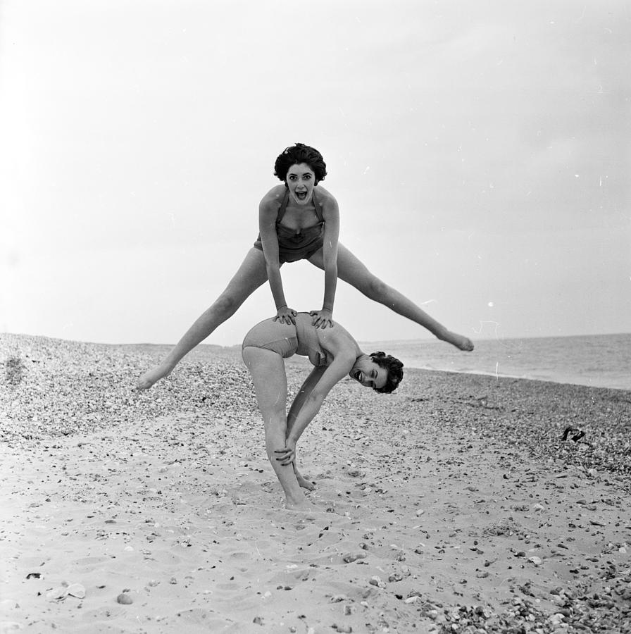 Beach Leap-frog Photograph by Harry Kerr