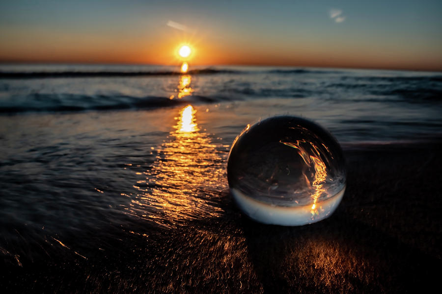 Beach sun rise with glass ball by Sven Brogren