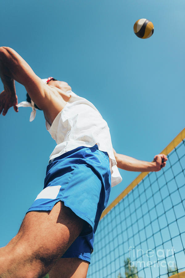 Beach Volleyball Photograph - Beach Volley Player At The Net by Microgen Images/science Photo Library