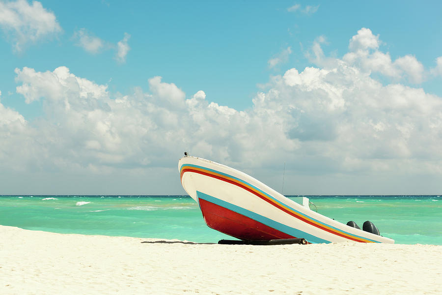 Beach With Fishing Boat On Caribbean Photograph by Yinyang