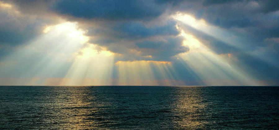 Sun Light Photograph - Beams Of Sunlight Rays Shining Through Dramatic Clouds Onto The  by Gill Copeland