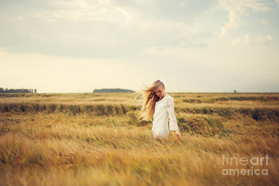 Woman Photograph - Beautiful Blonde Walks Into The Field by Aleshyn andrei
