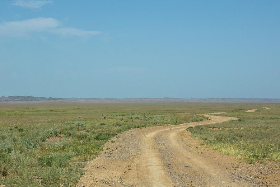 Beautiful landscape of steppe and stone mountains along the road by Kim Vermaat