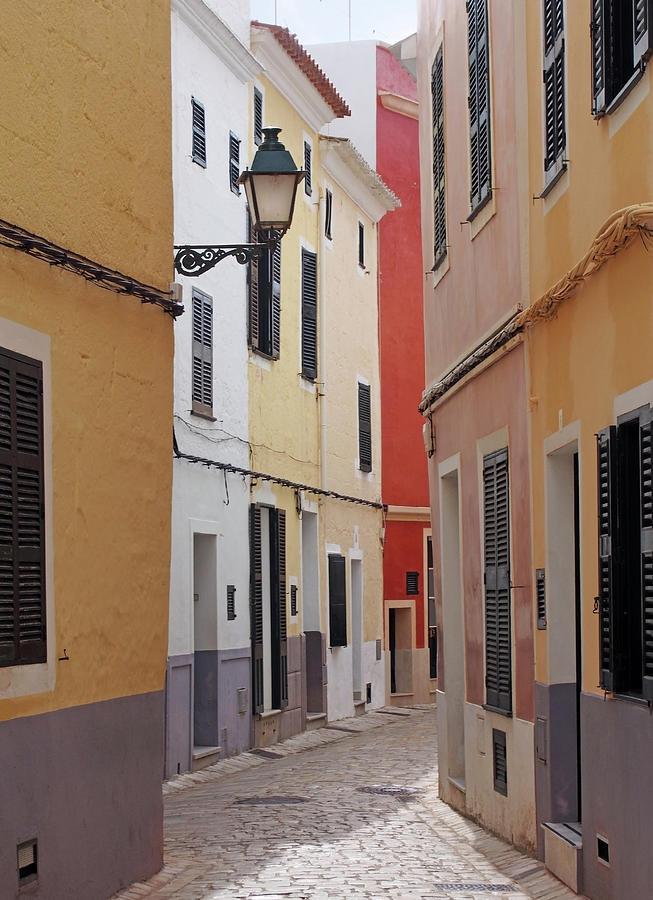 beautiful sunlit cobbled quiet street in ciutadella menorca spain by Philip Openshaw