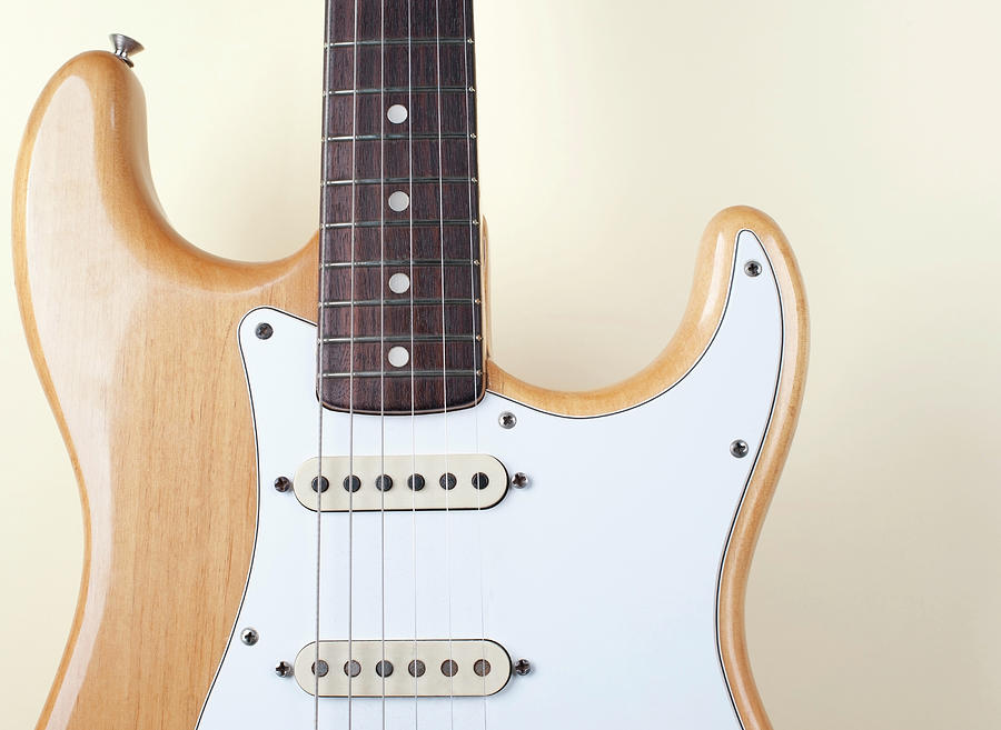 Beige Wood Textured Electric Guitar Photograph by Neyya