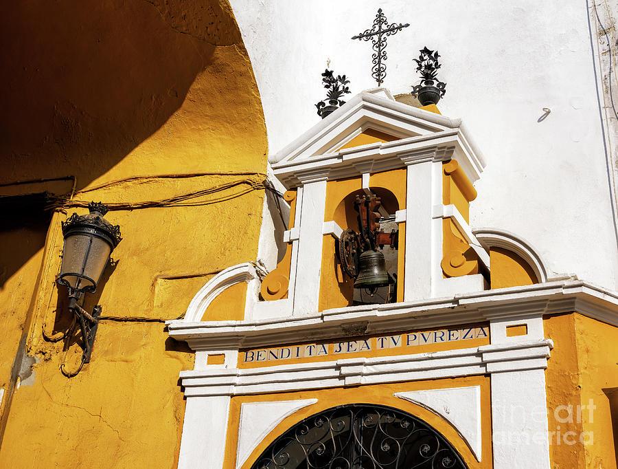 Bell at the Postigo del Aceite in Seville by John Rizzuto