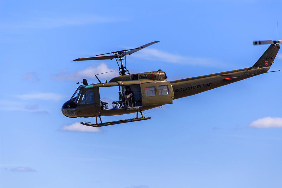 Bell UH-1 in Flight by Doug Camara