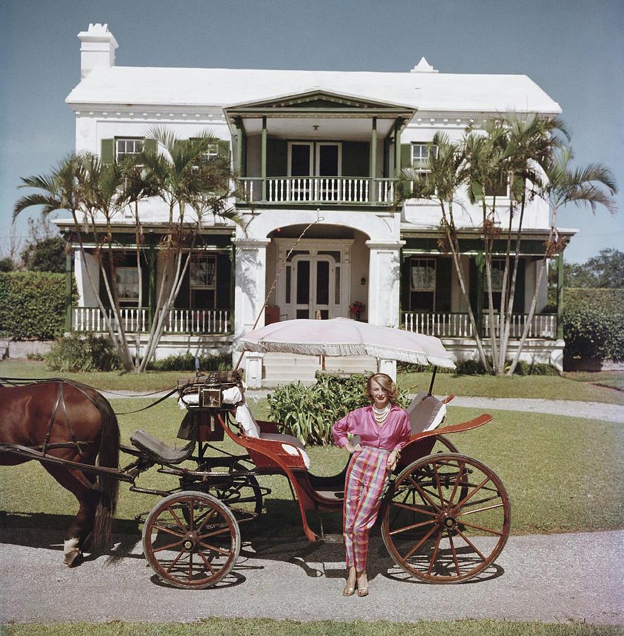 Bermudan Hostess Photograph by Slim Aarons