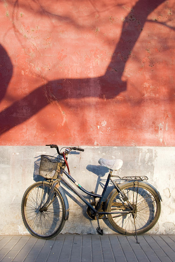 Bicycle Against Red Wall Photograph by Frankvandenbergh
