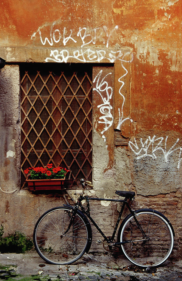 Bicycle Against Wall At Trastavere Photograph by Izzet Keribar
