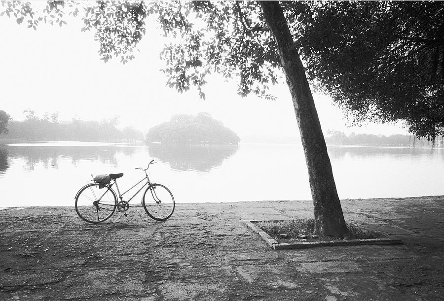 Bicycle And Bay Mau Lake Lenin Park Photograph by Walter Bibikow