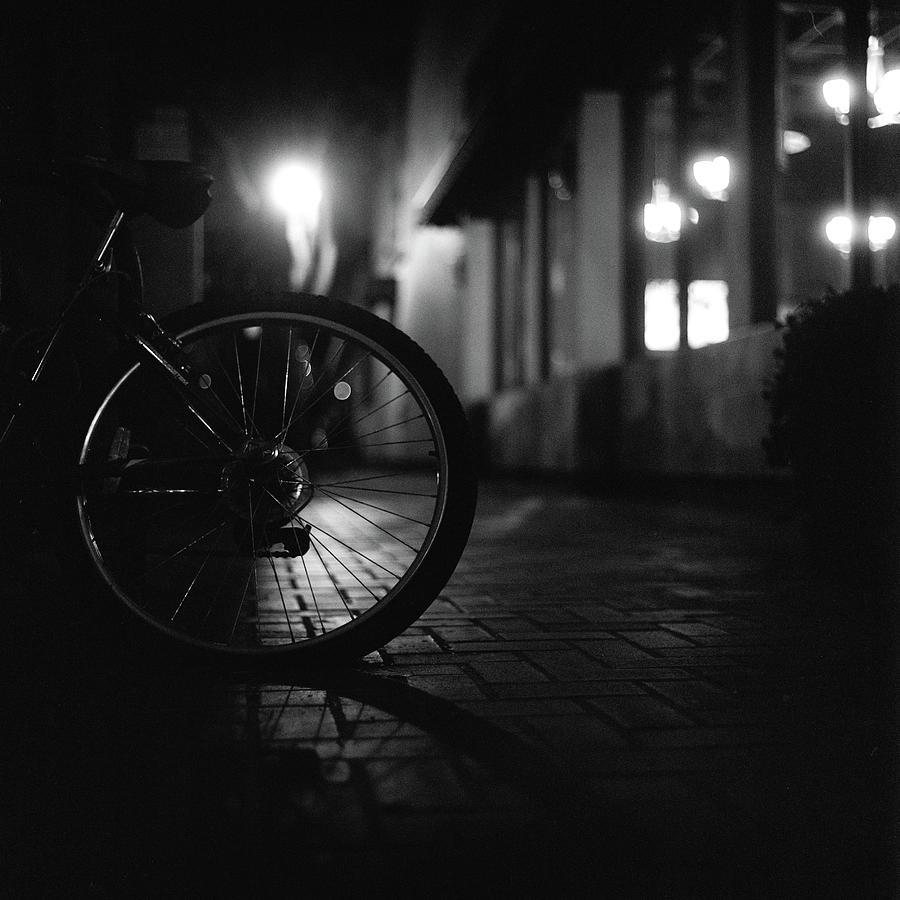 Bicycle In Dark Street Photograph by Satoshi Otani