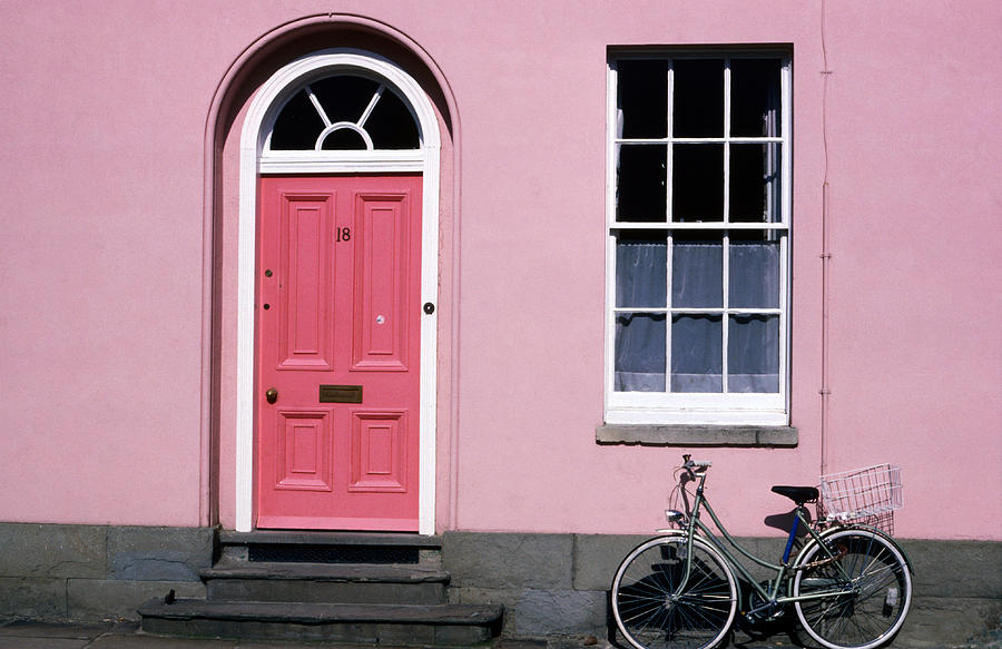 Bicycle Leaning Against Pink House Photograph by David Tomlinson