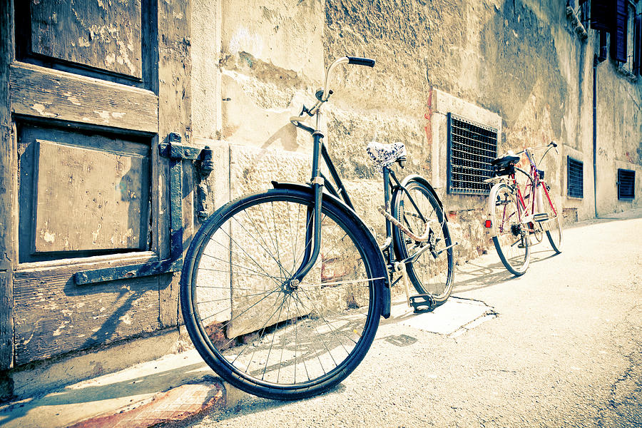 Bicycle Leaning Against Wall Photograph by Mauro grigollo