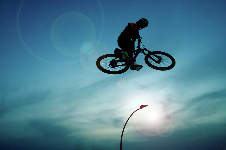 Bicycle Trick Rider Photograph by Photostock-israel