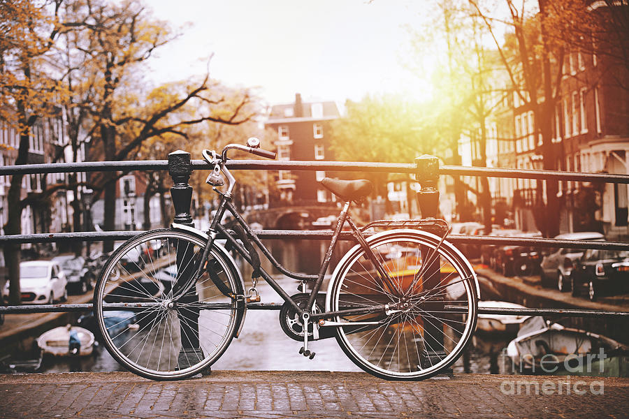 Bicycles Parked On A Bridge In Amsterdam Photograph by Serts
