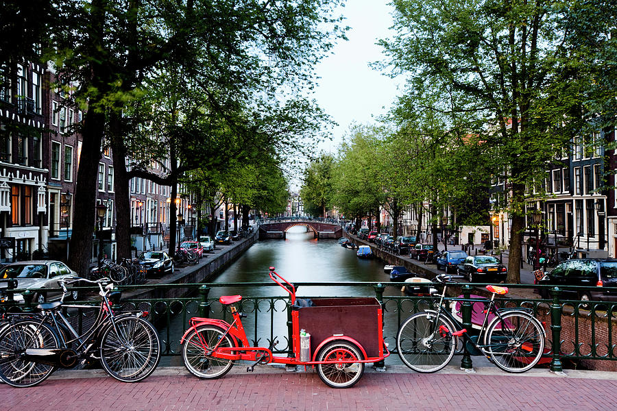 Bicycles Parked On Bridge Over Photograph by Jorg Greuel