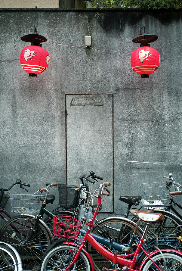 Bicycles Stand In Kyoto Photograph by (c) Anthony Rowlett