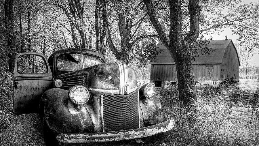 Big Ford on the Farm Lane Black and White by Debra and Dave Vanderlaan