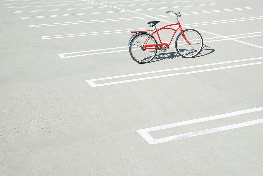 Bike In Empty Parking Lot Photograph by Peter Starman