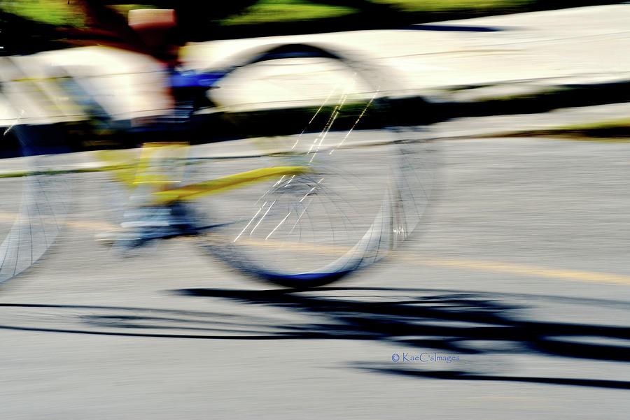 Biking Motion and Morning Shadow by Kae Cheatham