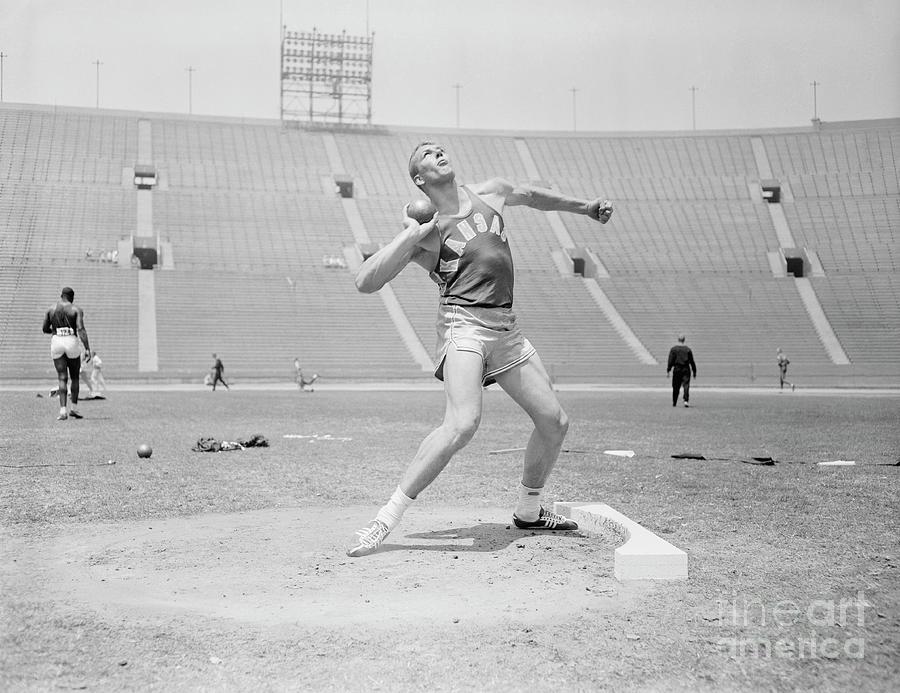 Bill Nieder Holding A Shotput Photograph by Bettmann