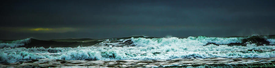 Black diamond beach crashing waves by Kevin Banker