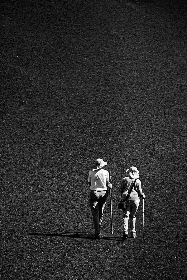 Blackscape -- Hikers on Inferno Cone in Craters of the Moon National Monument, Idaho by Darin Volpe