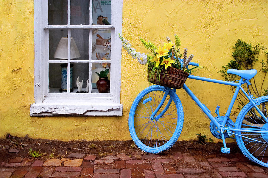 Blue Bike Against Yellow Wall Photograph by Kevin B. Moore
