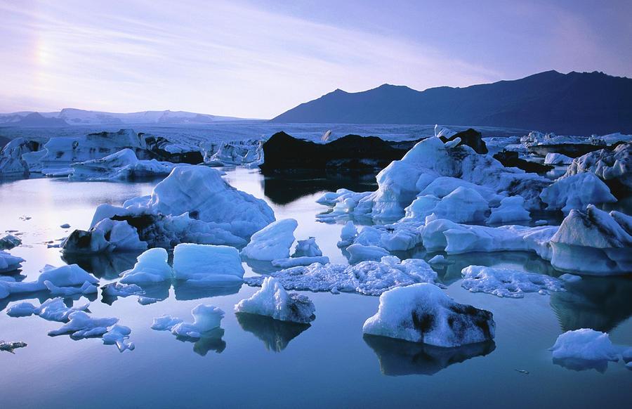 Blue Icebergs In Lake Jokulsarlon Photograph by Frans Lemmens