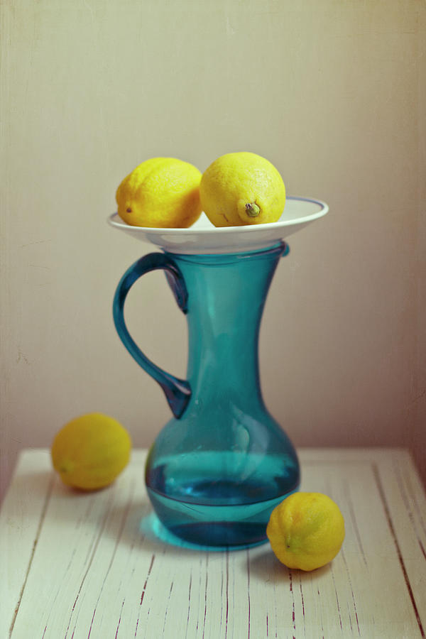 Blue Pitcher With Lemons On White Plate Photograph by Copyright Anna Nemoy(xaomena)