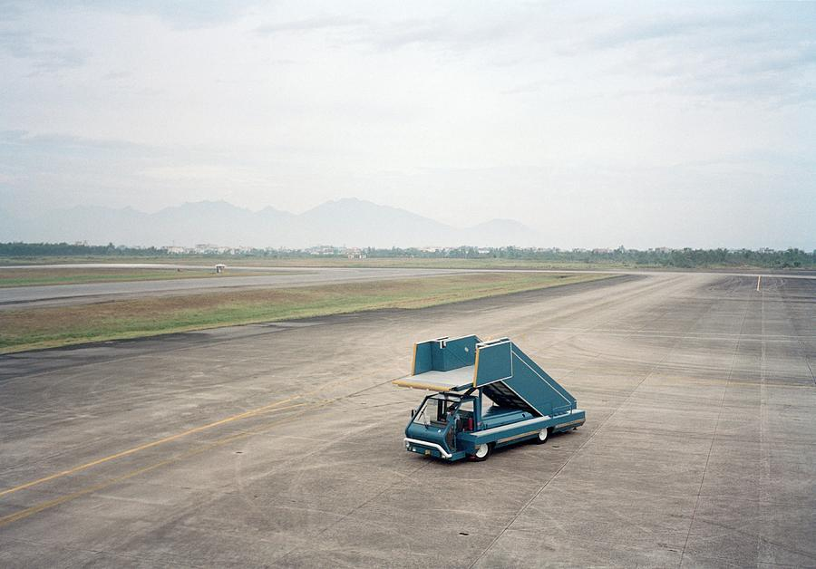Boarding Vehicle On Airport Runway Photograph by Tobias Titz