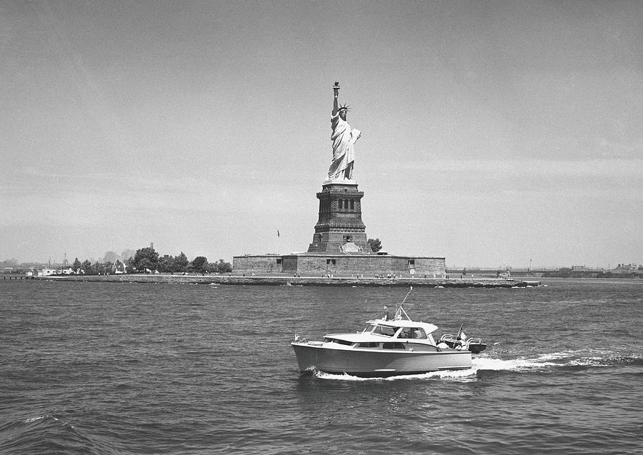 Boat Floating By Statue Of Liberty, New Photograph by George Marks