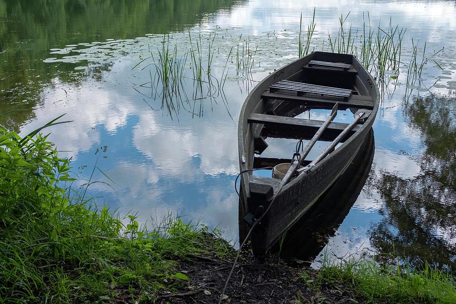Boat in a lake near Sweita Lipka, Northern Poland by Dubi Roman