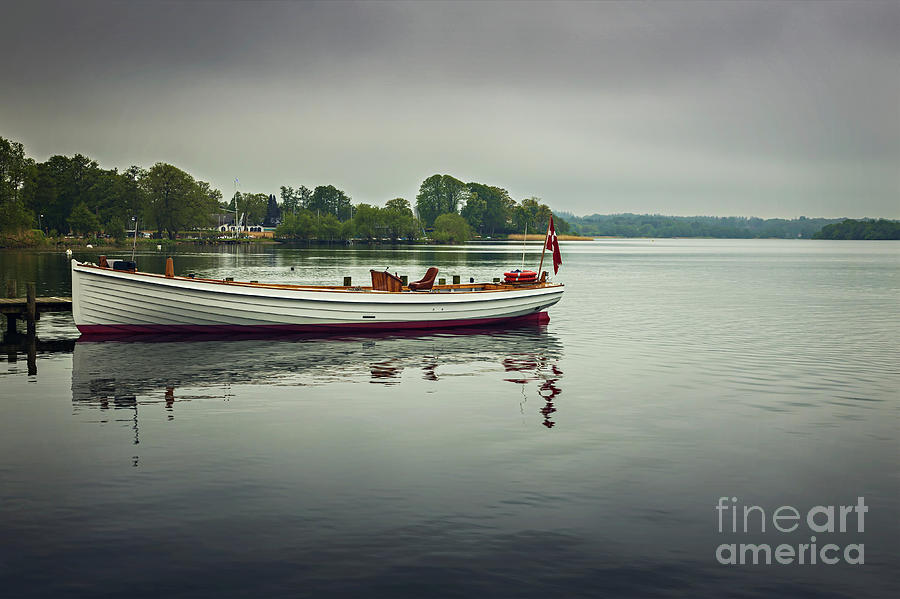 Boat on Esrum lake Denmark by Sophie McAulay