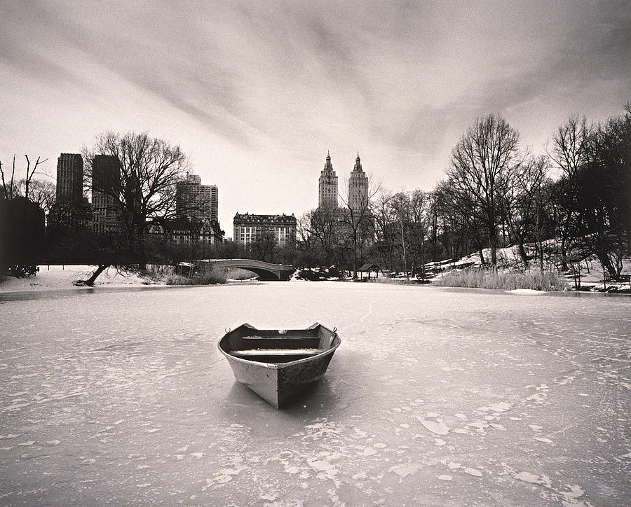 Boat On Frozen Pond In Central Park Photograph by Henri Silberman