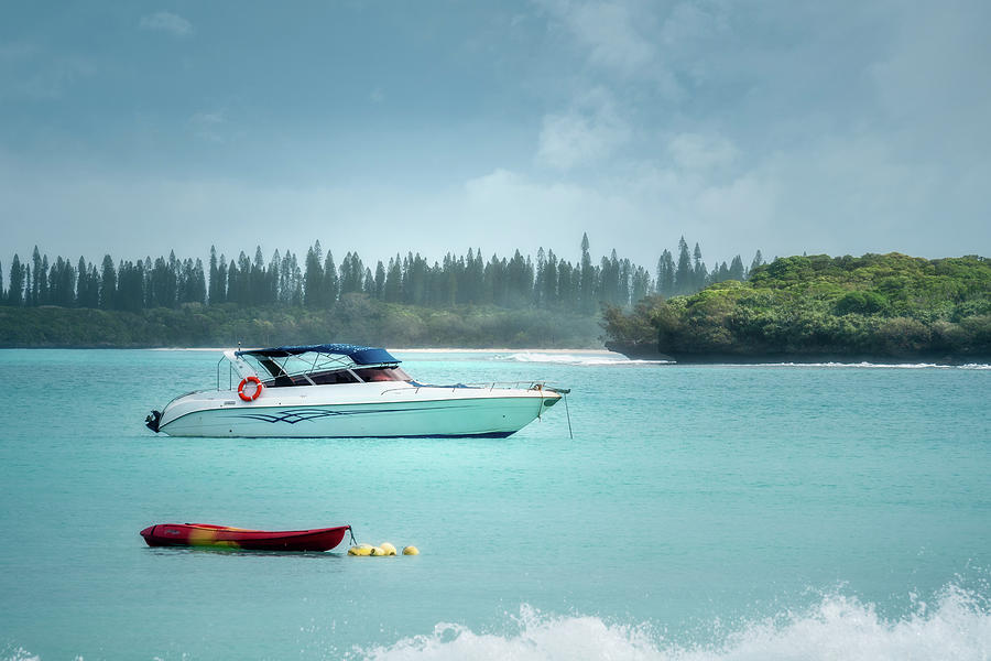 Boat on the water at Kuto Bay in New Caledonia by Daniela Constantinescu